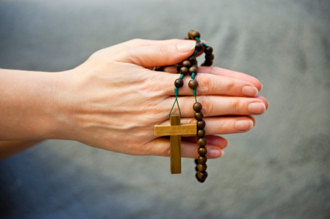 Praying-hands-with-Rosary-beads
